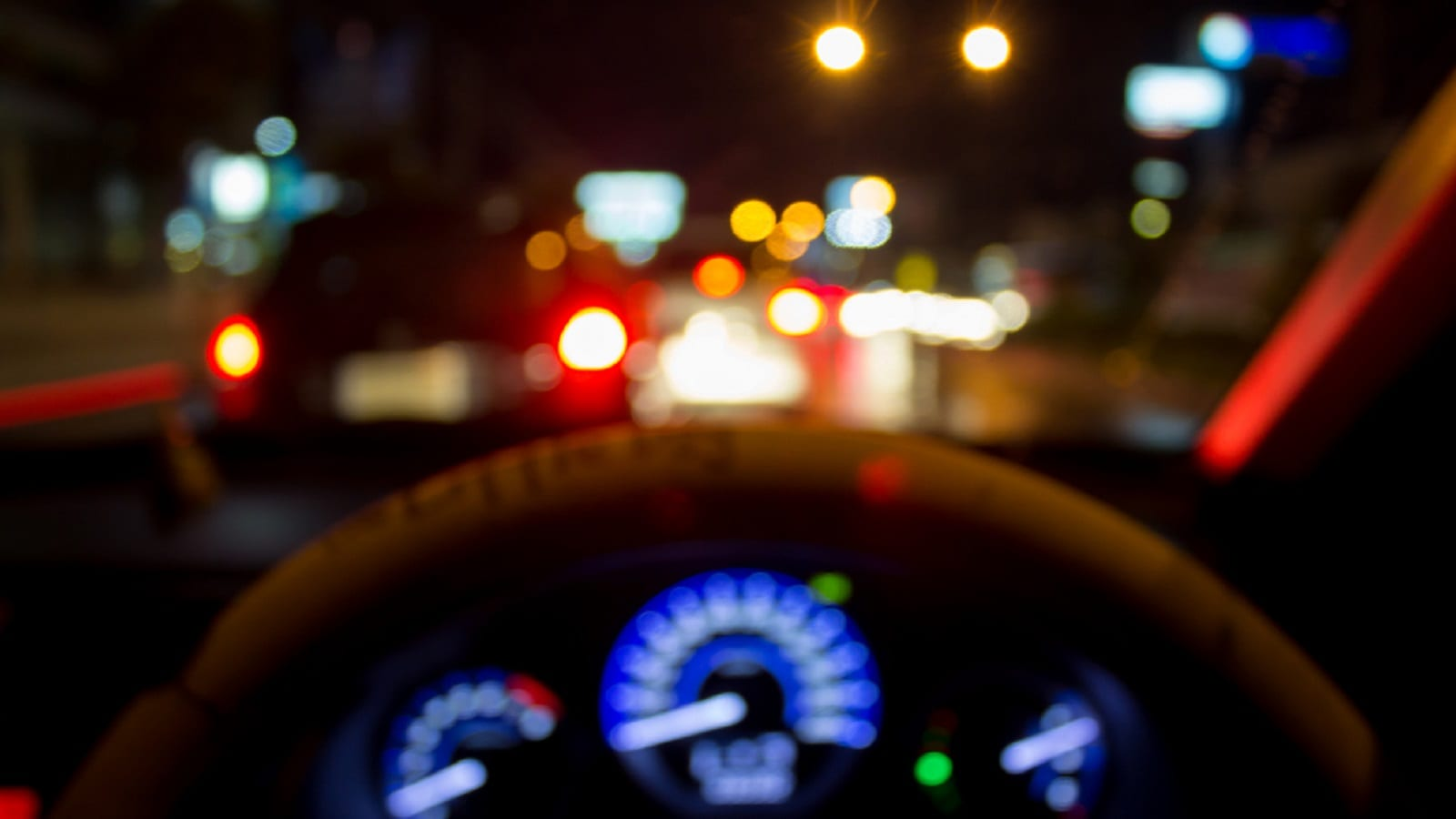 Driving Vehicle At Night Stock Photo