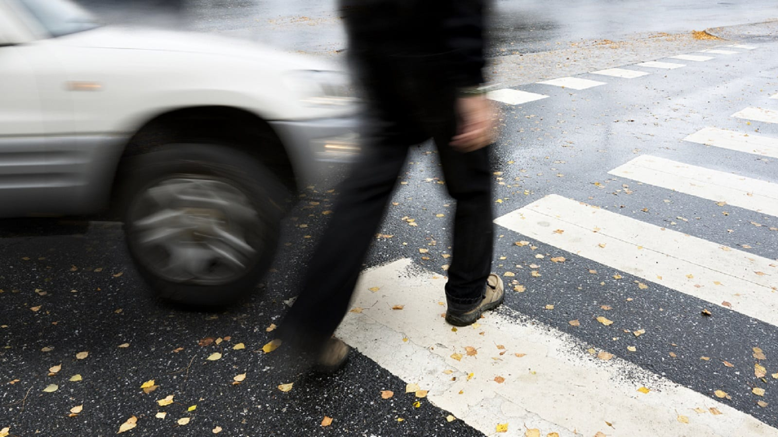 Small SUV Hitting A Pedestrian Stock Photo