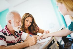 father-and-daughter-signing-paperwork