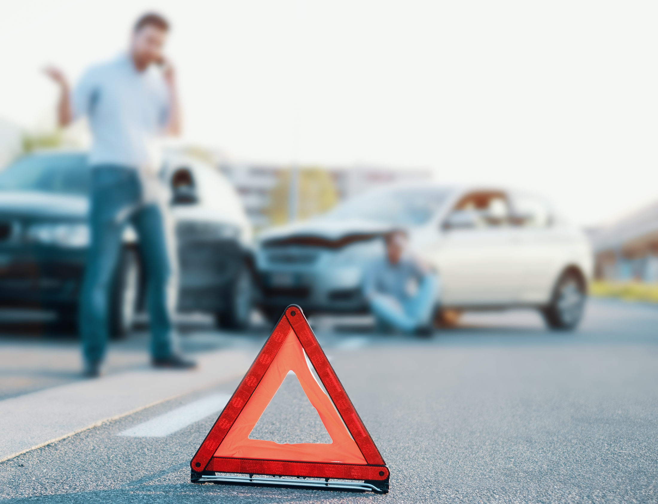 man calling a car accident lawyer after a car accident in Fayetteville