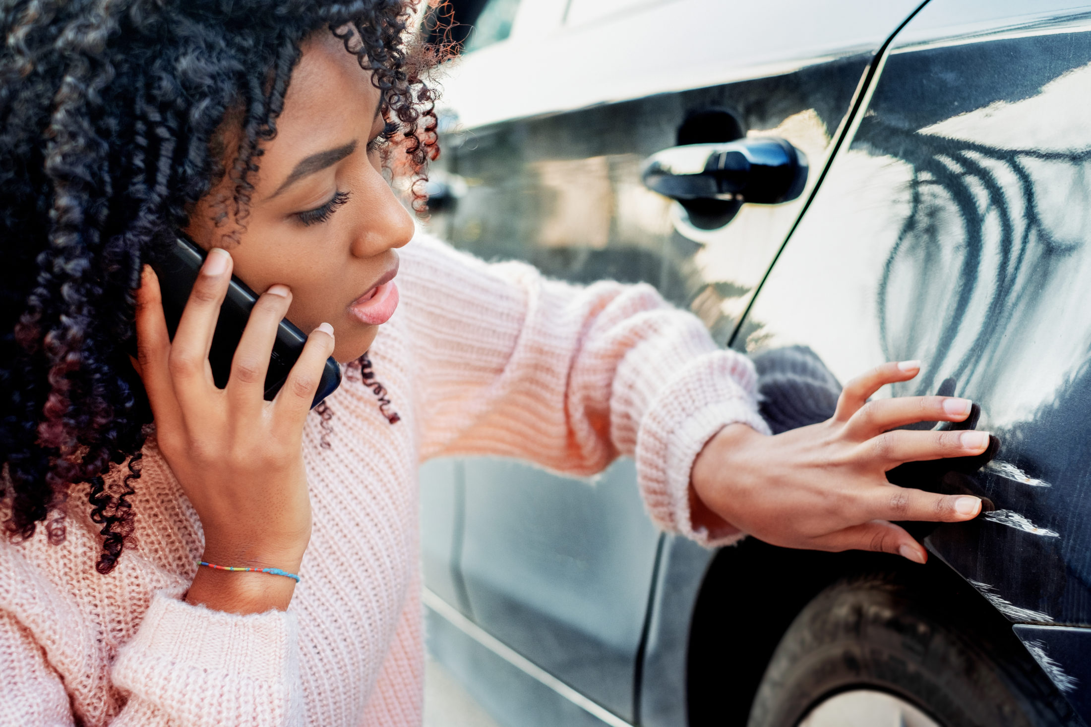 woman calling her insurance provider to file a car accident claim