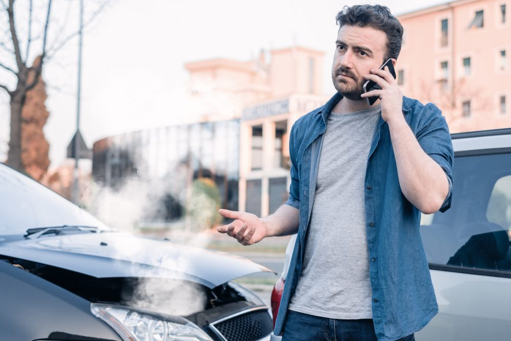 A man calling his lawyer after getting into a car accident in Fayetteville.