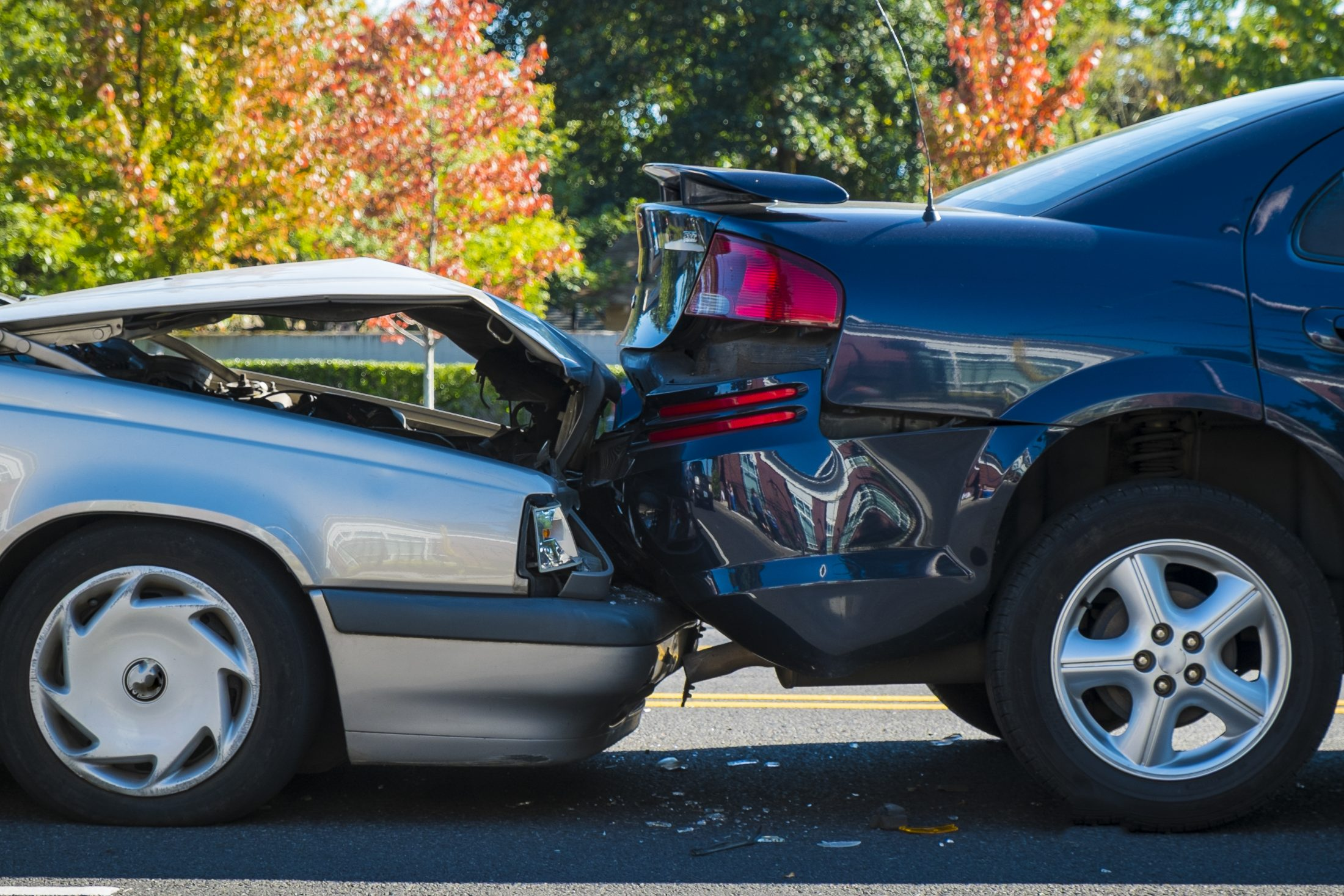 Two cars after a rear-end accident on the road in Fayetteville.